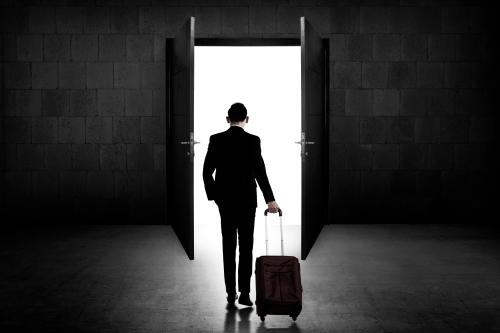 Back view of business man standing toward door. Career opportunity concept